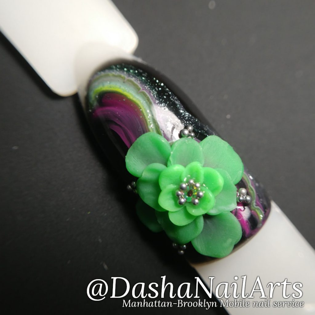 black and green 3D gel flower nail design with marble pattern