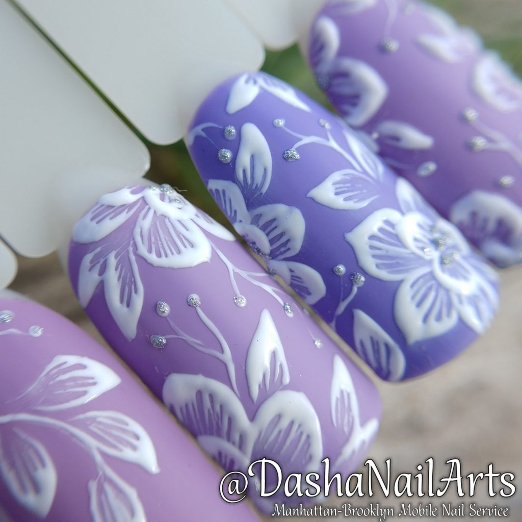 Purple 3D nails with flower patterns
