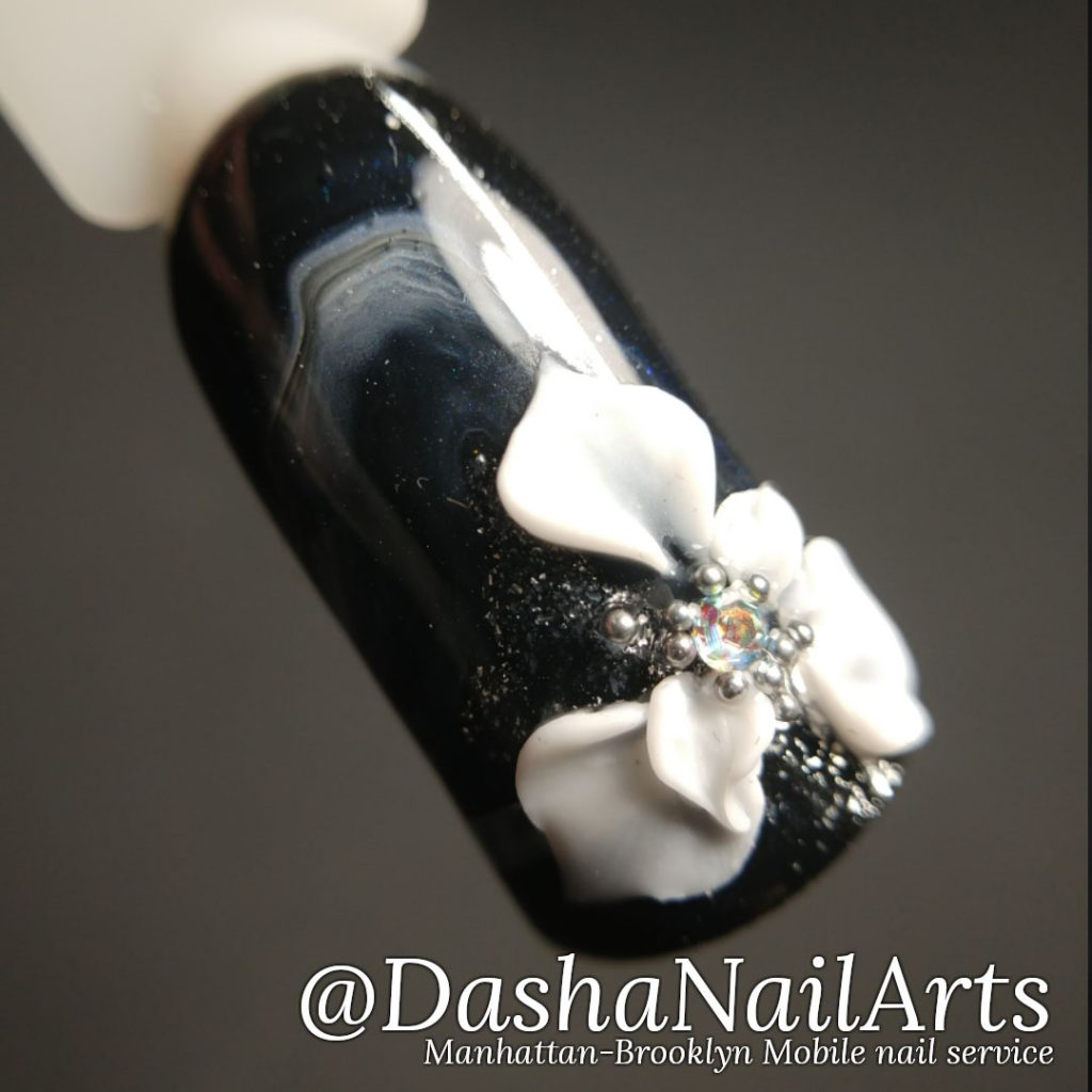 Black and white 3D gel flower nail design with marble pattern