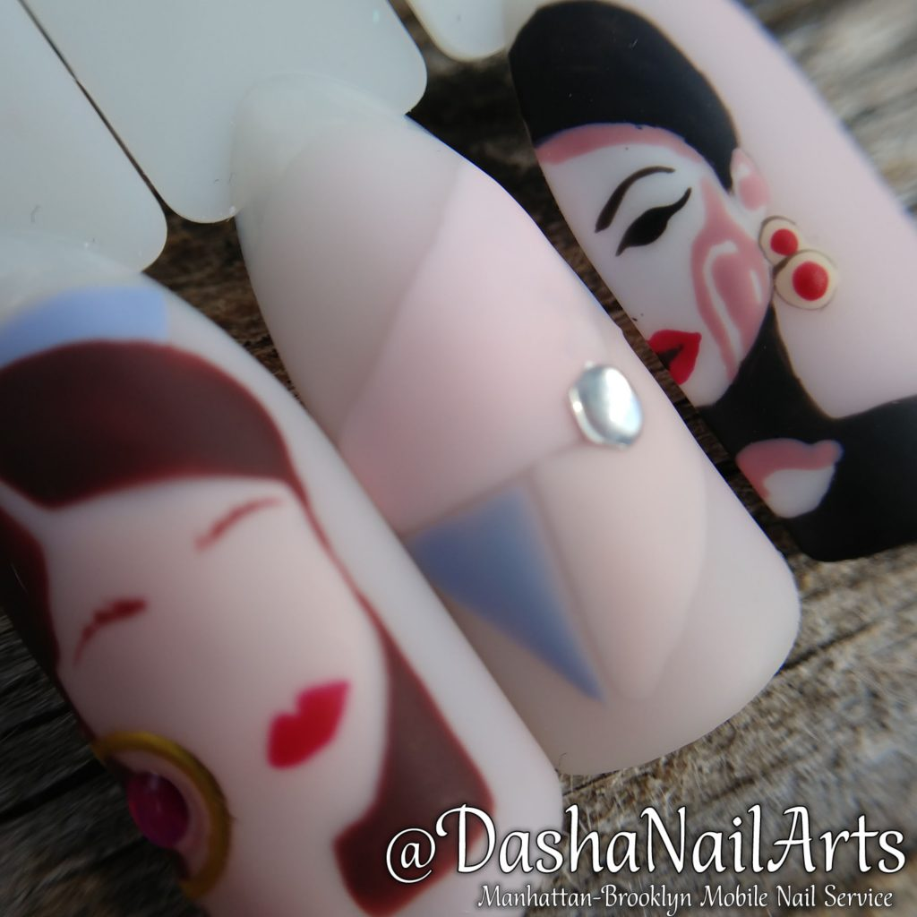 Nails with hand drawn woman face