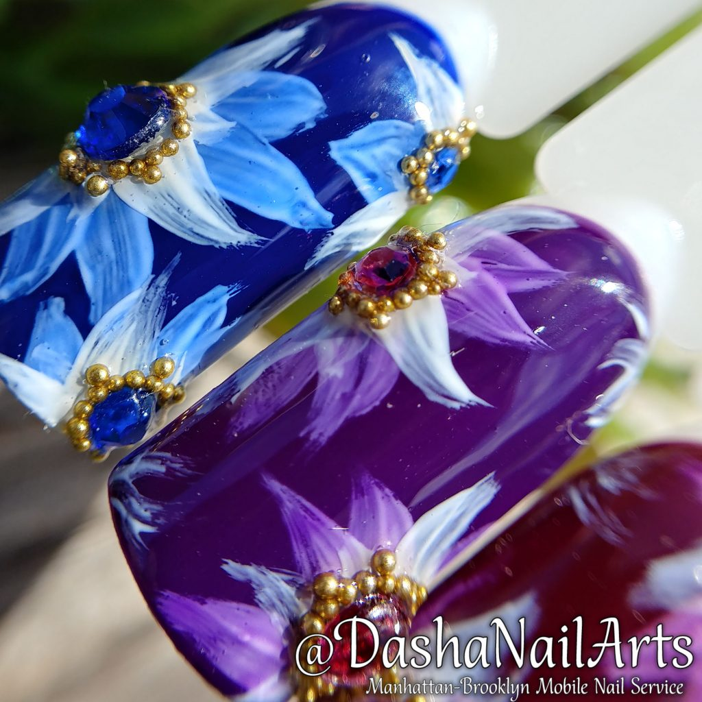 Flower nail art with diamonds and gold bits