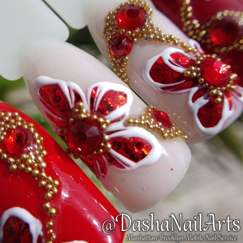 Red diamond flower nail design