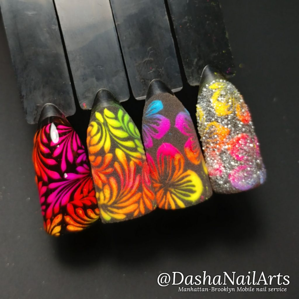 Neon nails with floral patterns